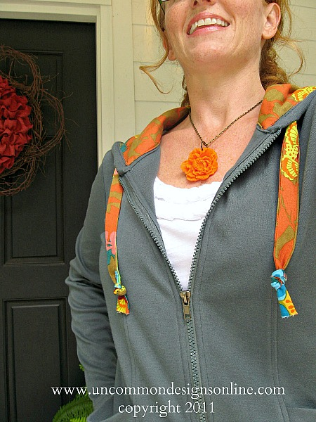 Adorable sweatshirt update with beautiful fabric! Take a plain hoodie up a notch and create this fun and stylish fabric lined hoodie. #sewing #fabric #annamariahorner #hoodie #refashion