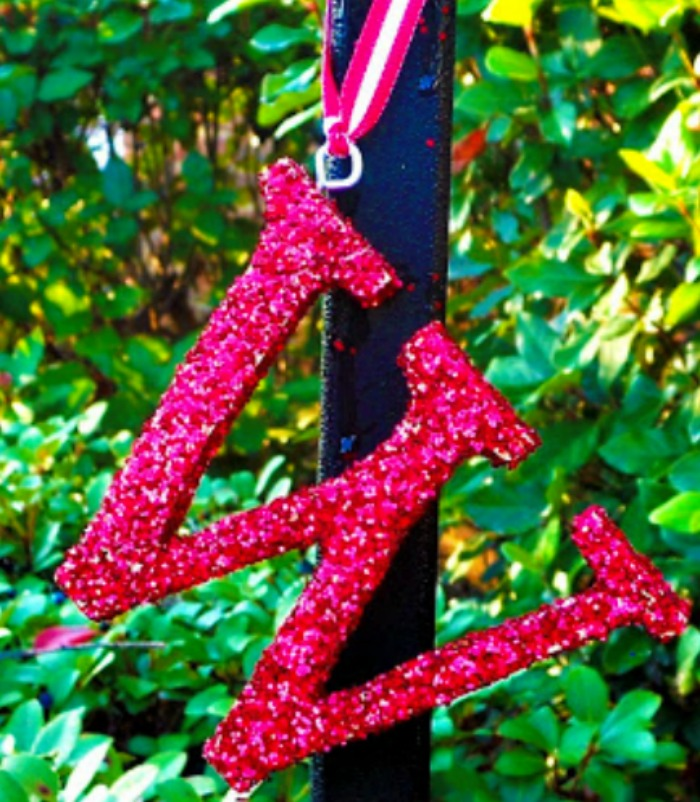 These glittered initial ornaments are such a simple gift idea. They look beautiful on a tree or as a gift topper.  Everyone loves a personalized gift and they will adore these monogrammed ornaments. See how at http://www.uncommondesignsonline.com/