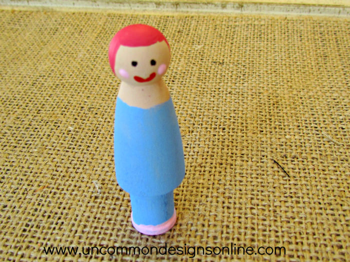 peg doll snow globe ornament