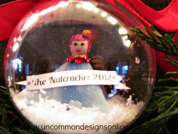 peg doll snow globe ornament