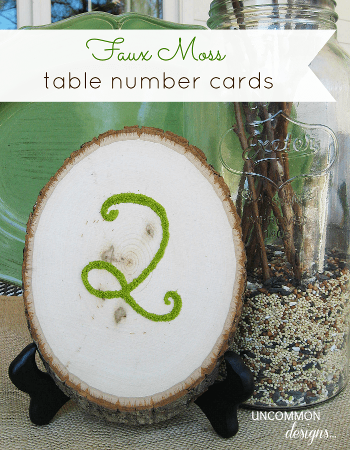 DIY Faux Moss Table Number Cards. Use slices of wood and a great faux moss product to create these. #weddingideas #moss #tablecards