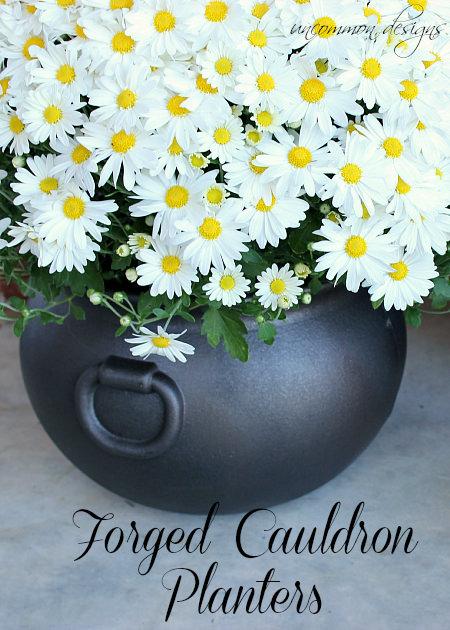 spray painted cauldron planter