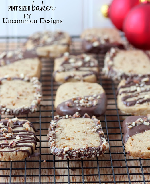 Chocolate Dipped Toffee Cookies... The yummiest sweet treat you have ever given!  #Christmas  #Cookies  via www.uncommondesignsonline.com
