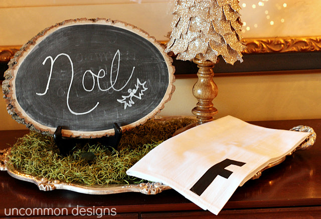 No Sew Monogrammed Towel... the Perfect Gift for Everyone on your list.  All you need is a flour sack towel and iron on letters.  #Christmas  #NoSew  #HandmadeGifts  via www.uncommondesignsonline.com
