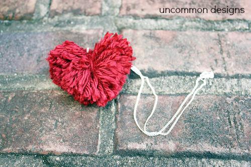 DIY Pom Pom Heart Necklace... a cute and easy Valentine's craft. via www.uncommondesignsonline.com #PomPom #ValentinesDay