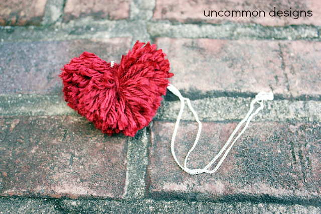 DIY Pom Pom Heart Necklace... a cute and easy Valentine's craft.  via www.uncommondesignsonline.com #PomPom  #ValentinesDay