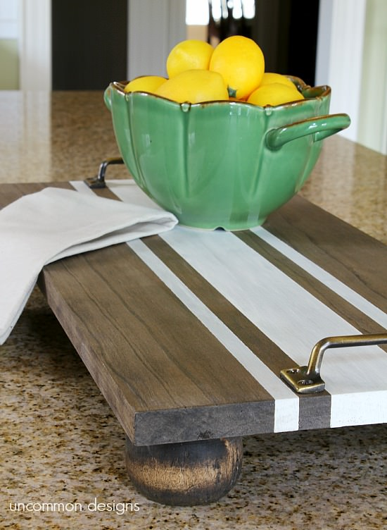 Make your own DIY Striped Serving Tray with only a handful of items from the hardware store.  This tray is gorgeous for kitchen decor and makes the perfect holiday gift idea, too!   #DIYHomeDecor #DIYProject #KitchenDecor #HomeDecorIdeas #GiftIdeas #HolidayGiftIdeas #FarmhouseDecor #HolidayFarmhouseDecor #FarmhouseFaves
