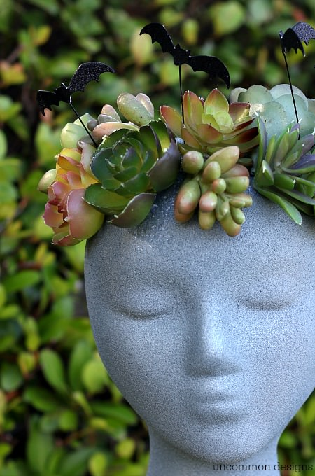 Make a faux Halloween Goddess Sculpture with a foam wig head.  Such a unique Halloween decoration! via Uncommon Designs