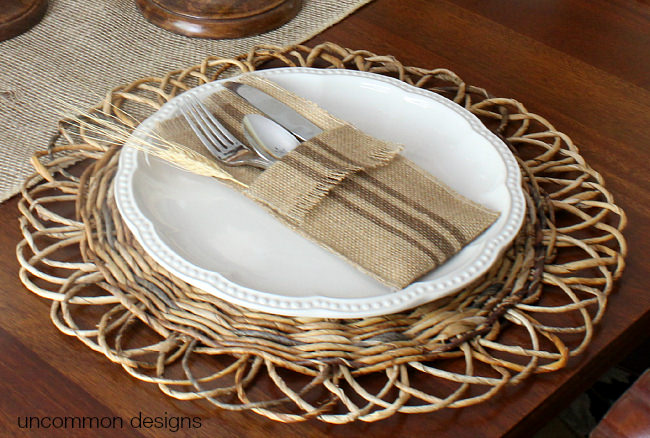 Grain sack stripe painted burlap utensil holders. No sew! Via Uncommon Designs