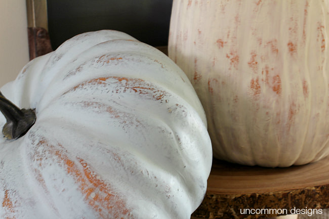 Easy 2 step distressed Painted Pumpkins. DecoArt Chalky Finish Paint adds warmth and color to your fall and Thanksgiving decor. Via Uncommon Designs