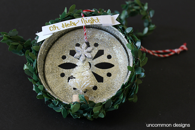 Create a precious Mason Jar Lid Christmas Ornametn via Uncommon Designs. Includes a sweet vintage bottle brush tree and glitter.
