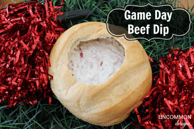 Warm and creamy Game Day Beef Dip via Uncommon Designs. Add it to your next tailgating party.