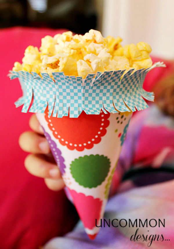 Make a simple treat of popcorn the star of the birthday party! Via Uncommon Designs.