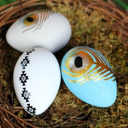 Add a little paint and a temporary tattoo for these gorgeous modern Easter eggs by Uncommon Designs