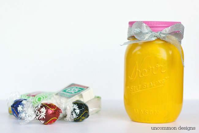 Give your favorite student or teacher a treat with this adorable painted back to school painted mason jar by Uncommon Designs!