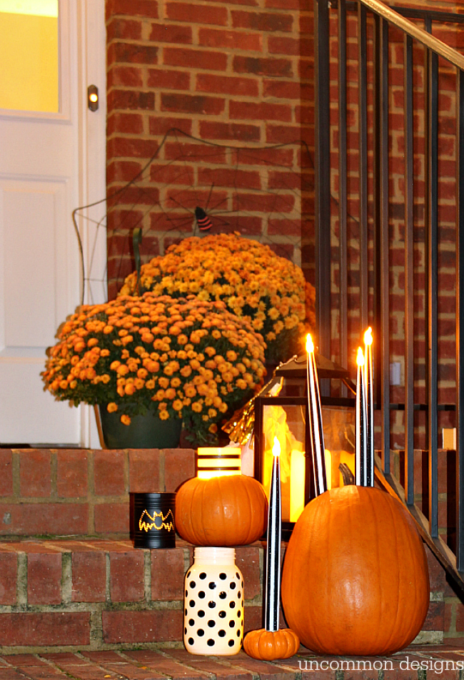 Make pumpkins into candle holders for your battery operated taper and pillar candles. So easy, but such a creative Halloween porch idea!   Uncommon Designs