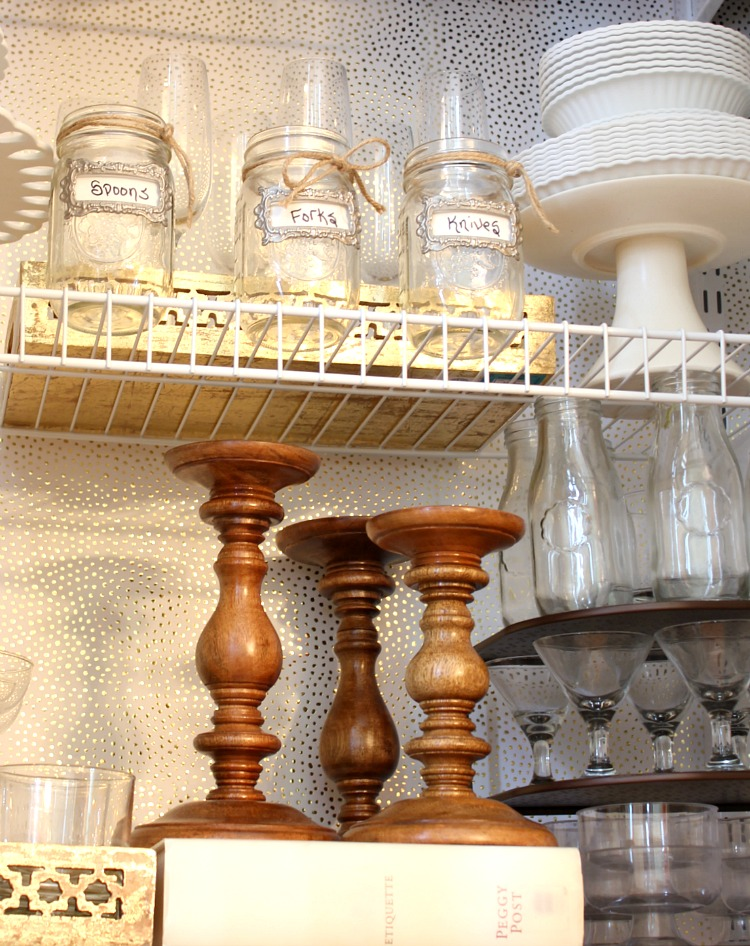 Transform a rarely used coat closet into an entertaining closet. It is the perfect place for storage of cake stands, trays, candle sticks and glassware. Having everything at your fingertips makes entertaining a breeze and there is still room for storing your guests coats!