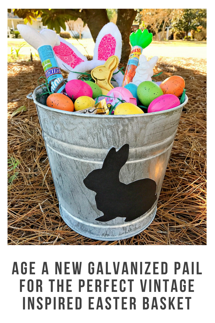 How to age a new galvanized pail to make the perfect vintage inspired Easter basket. Just look at that adorable bunny silhouette and anyone can do this! #ad #SweeterEaster