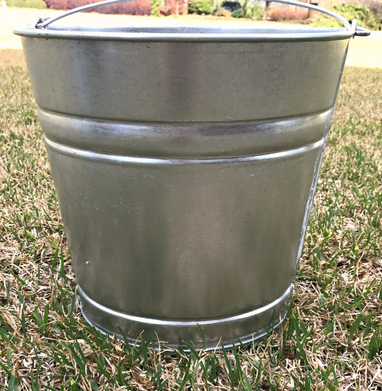 How to age a shiny new galvanized metal pail. Go from shiny to vintage in just a few minutes.