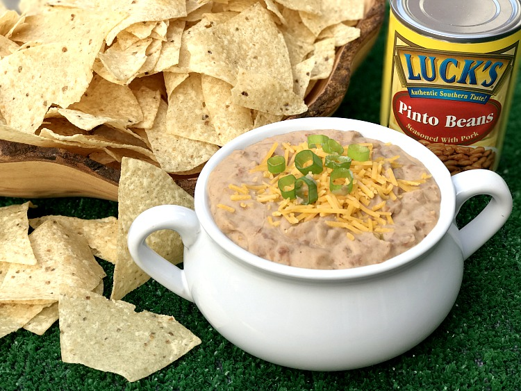 It is football time and my favorite season for this recipe for Spicy Bean Dip. Grab your cheese, Luck's Pinto Beans and favorite flavorings for this super quick dish!