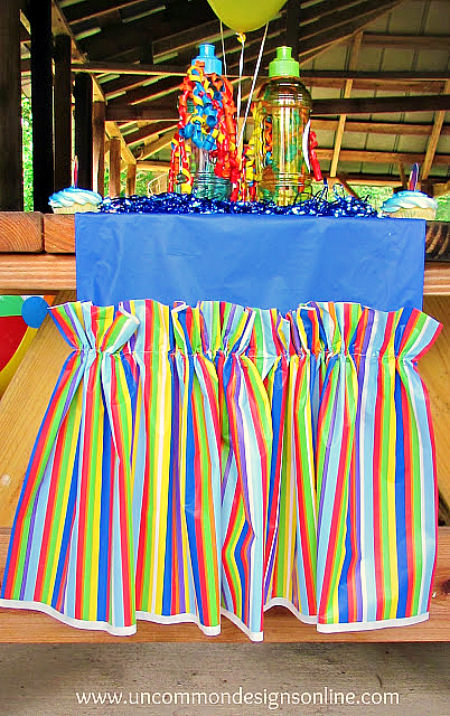 What a great idea...Make an Easy and Inexpensive Table Runner out of Plastic Tablecloths!  Perfect for any occassion!  www.uncommondesignsonline.com #partyplanning  #partyideas