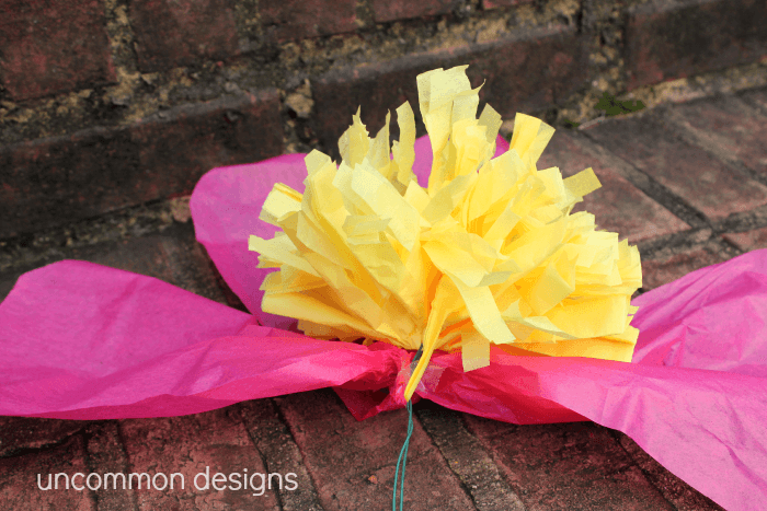Such a cool and easy craft... make giant tissue paper flowers! www.uncommondesignsonline.com #tissuepoms #partyplanning