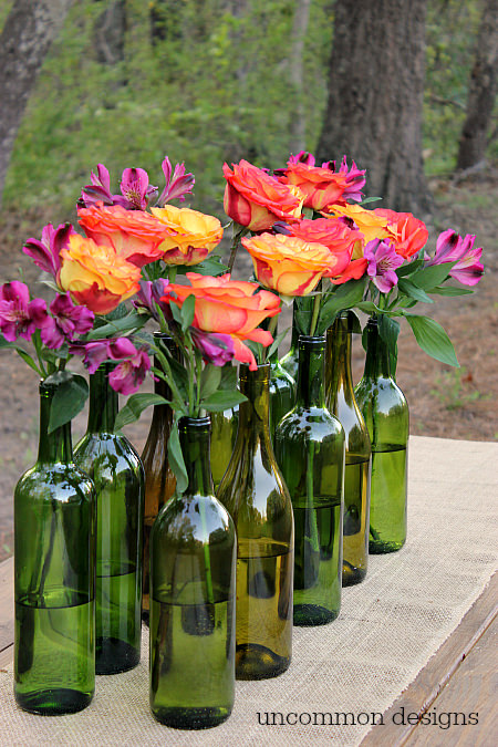 Make an Easy and Elegant Floral Centerpiece out of Wine Bottles! Perfect for weddings, bridal showers, and parties! www.uncommondesignsonline.com #WeddingCenterpiece #OutdoorEntertaining