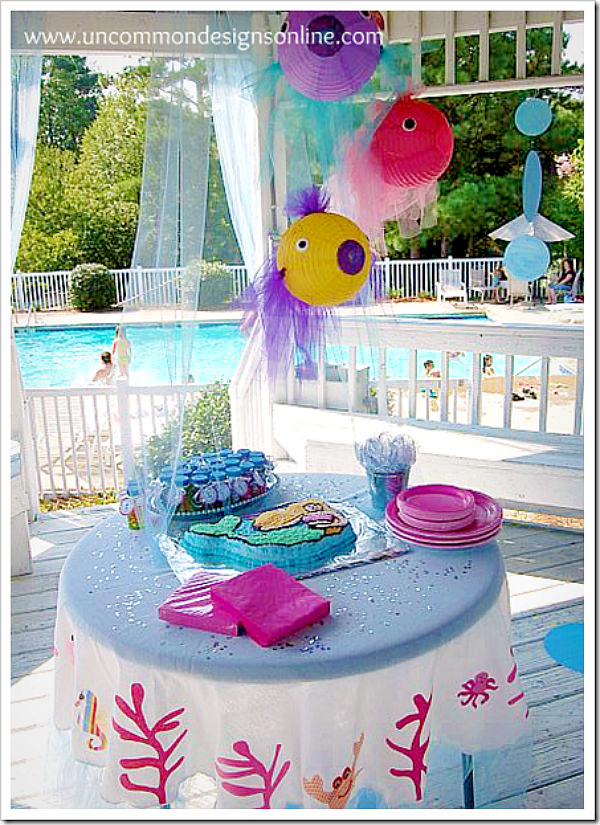 Mermaid birthday party with fabulous decorations and ideas via Uncommon Designs.