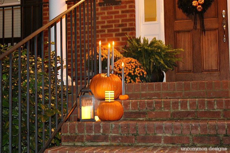 Make pumpkins into candle holders for your battery operated taper and pillar candles. So easy, but such a creative Halloween porch idea! | Uncommon Designs